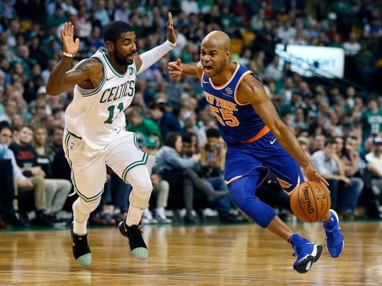 New York Knicks' Jarrett Jack (55) drives past Boston Celtics' Kyrie Irving (11) during the first quarter of an NBA basketball game in Boston, Tuesday, Oct. 24, 2017. (AP Photo/Michael Dwyer)