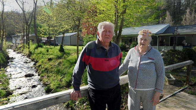 Lloyd Lansing, left, and his wife, Johnnie Lansing, live next door to their daughter and down the road from their grandson in rural Pike County.