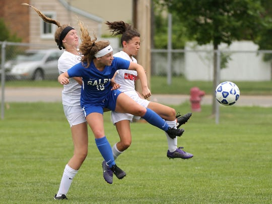 It's a soccer scrum as Canton's Bella Wingate (left) and Ari Ontko put the squeeze on Salem's Sydney Smith (10).