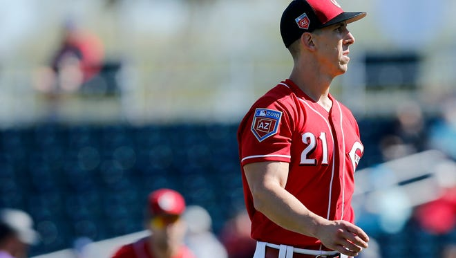 Cincinnati Reds pitcher Michael Lorenzen (21) returns to the dugout after the top of the second inning of the Spring Training game between the Cincinnati Reds and the Colorado Rockies at Goodyear Ballpark in Goodyear, AZ, on Saturday, Feb. 24, 2018.