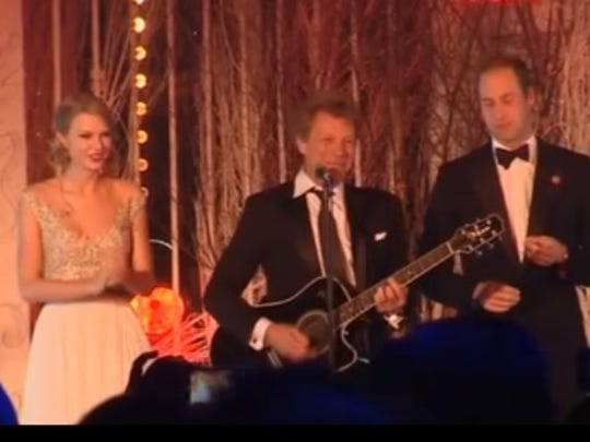 Taylor Swift and Jon Bon Jovi were joined on stage by Prince William at a London benefit Tuesday.