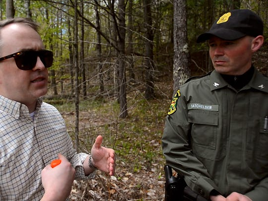 From left, epidemiologist Bradley Tompkins with the Vermont Department of Health and Vermont Game Warden Col. Jason Batchelder talk about precautions people can take to keep ticks off you when you are in the woods, stressing that a thorough check of your body is crucial to find any ticks early, before they get a chance to bite and transmit Lyme disease, the Powassan virus or other tick-borne illnesses.