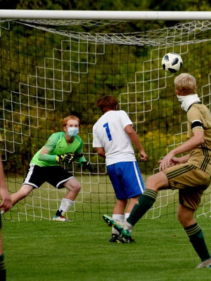 St. Mary Catholic Central's Andrew Pope fires a shot on Jefferson goalkeeper Levi Kolak last season. Defending for Jefferson is Gio Beaudrie (1).