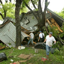 People look at one of several destroyed cabins on the banks of the Blanco River in Wimberley, Texas, on May 24, 2015. Flooding in Texas and Oklahoma has led to numerous evacuations.