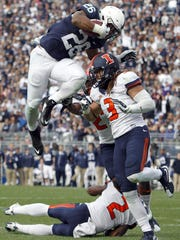 STATE COLLEGE, PA - OCTOBER 31: Saquon Barkley #26 of the Penn State Nittany Lions jumps over defenders V'Angelo Bentley #2, Taylor Barton #3 and Eaton Spence #27 of the Illinois Fighting Illini for a 7 yard touchdown run in the fourth quarter during the game on October 31, 2015 at Beaver Stadium in State College, Pennsylvania. (Photo by Justin K. Aller/Getty Images)