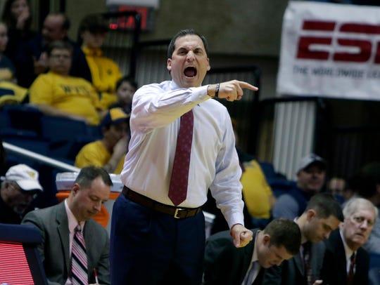Iowa State head coach Steve Prohm screams directions