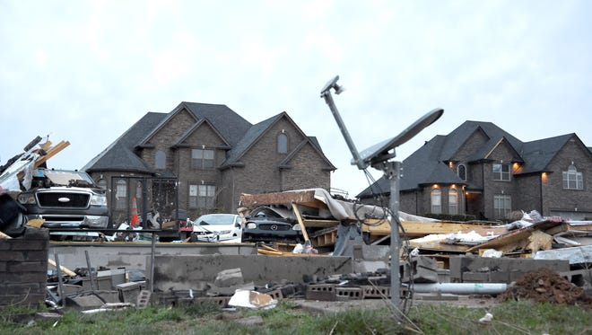 A home at the corner of Covey Rise Circle and Green Grove Way is reduced to rubble Sunday, Feb. 25, 2018 after a fierce storm came through the Farmington subdivision in Clarksville, Tenn. on Saturday night.