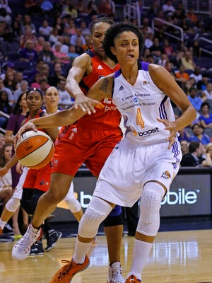 Mercury forward Candice Dupree (4) is fouled by Washington Mystics forward Monique Currie (25) during the first half of their WNBA game Tuesday, July 15, 2014 in Phoenix.