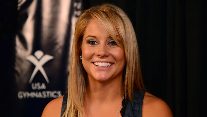 June 27, 2012; San Jose, CA, USA; USA Gymnastics olympian Shawn Johnson smiles while addressing the media in a press conference announcement during the 2012 USA Gymnastics Olympic Team Trials at HP Pavilion. Mandatory Credit: Kyle Terada-USA TODAY Sports