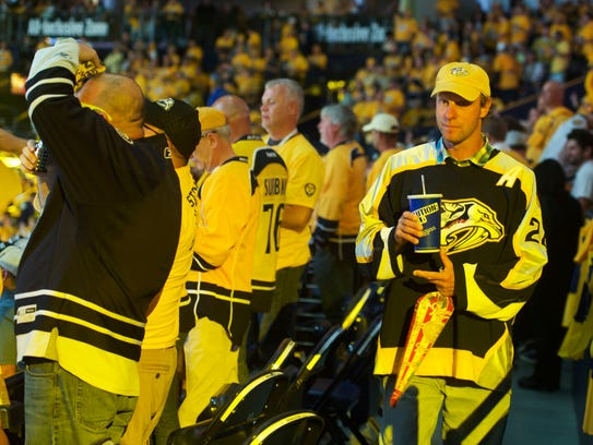 David Brkich walks with a soft drink during game 3