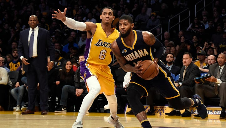Indiana Pacers forward Paul George (13) drives to the basket against Los Angeles Lakers guard Jordan Clarkson (6) during the second quarter at Staples Center.