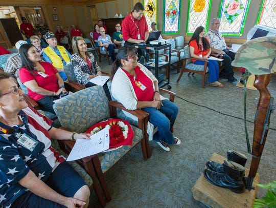 A group of people gathers at the Mesilla Valley Hospice