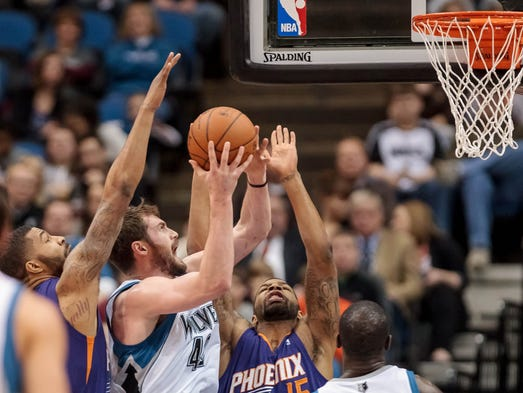 Minnesota Timberwolves forward Kevin Love (42) shoots in the first quarter against the Suns forward Marcus Morris (15) at Target Center.