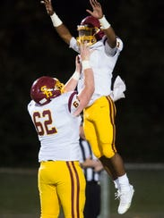 Science Hill's quarterback Jaylan Adams (11) celebrates