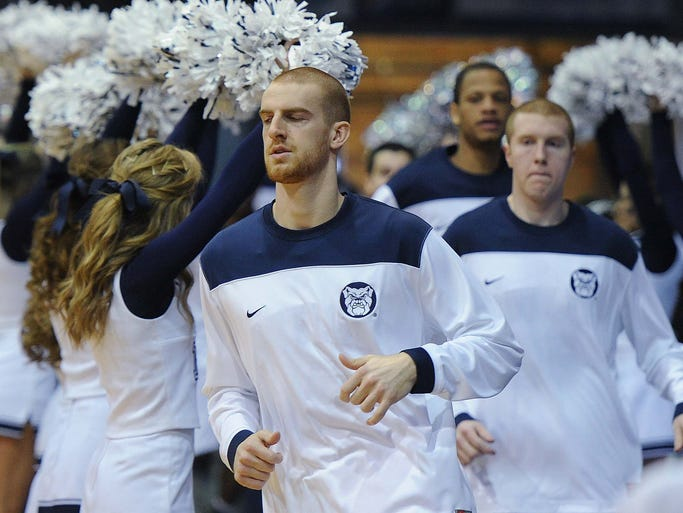 Erik Fromm and other Butler team member had shaved heads for charity. Butler lost 69-52 to St. Johns in basketball action at Hinkle Fieldhouse Saturday January 25, 2014.