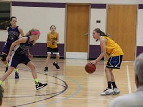 Ashley Joens playing basketball back in 2013.
