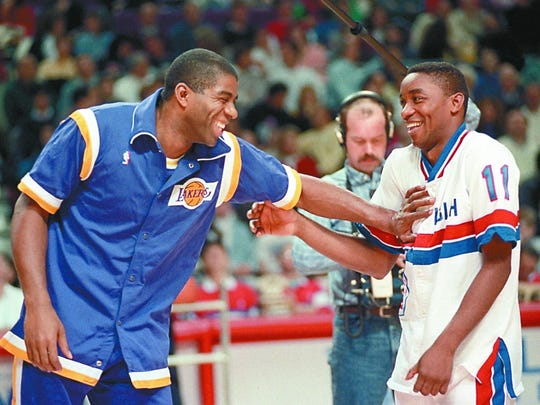 Lakers guard Magic Johnson and Pistons guard Isiah