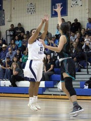 """Silver High's Aysia Salas says """"Bombs away"""" as she lets this one fly Thursday night. She had a game-high and team-leading 15 points to pace the Lady Colts against Onate."""