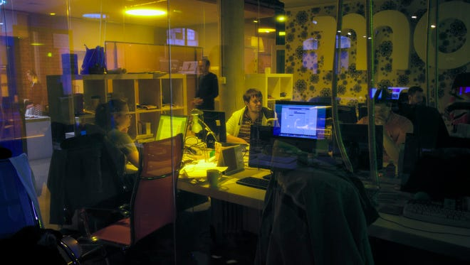 Journalists finish their last working day in  the independent news website Lenta.ru newsroom in Moscow on March 14, 2014.