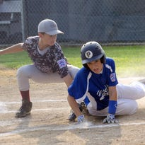 Nick Porcopio slides safely into home for Horseheads as Anthony Simpson of Huck Finn makes the tag. Horseheads won, 19-5.