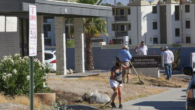 Friends of Well in the Desert clean up the charity's new drop-in and cooling center at 441 S. Calle Encilia near downtown Palm Springs on June 27, 2017.