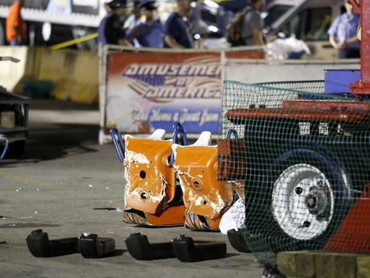 Authorities stand near damaged chairs of the Fire Ball