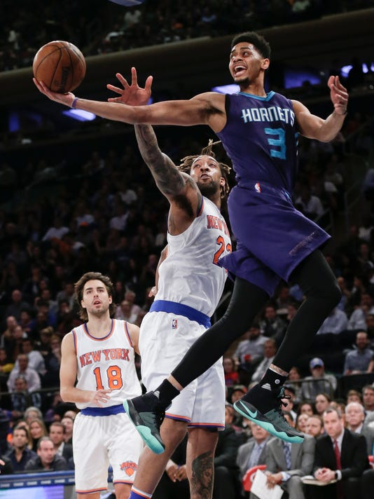 Charlotte Hornets' Jeremy Lamb (3) drives past New York Knicks' Derrick Williams (23) as Sasha Vujacic (18) watches during the first half of an NBA basketball game Wednesday, April 6, 2016, in New York. (AP Photo/Frank Franklin II)