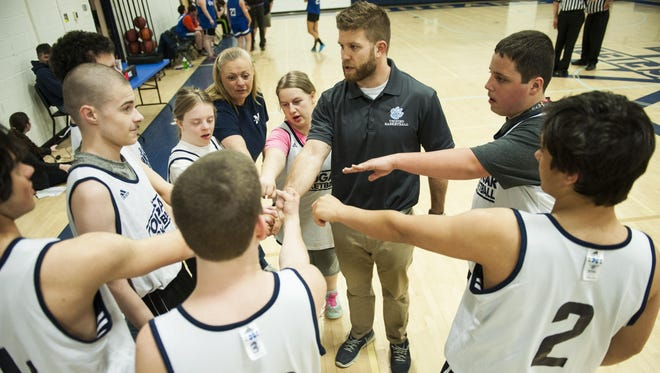 Mount Mansfield huddles together during the Unified basketball game between Colchester and Mount Mansfield on Monday afternoon in Jericho.