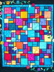 This queen-size, hand-stitched Garden Window quilt