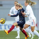 France's forward Eugenie Le Sommer (C) fights for the ball with U.S. defender Whitney Engen (R) and Morgan Brian (L) during a friendly on Feb. 8 in Lorient, western France. France won 2-0.