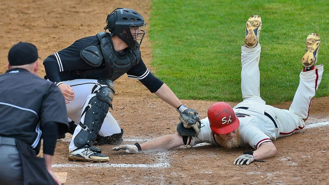 Cold Spring Rockies catcher David Jonas tags St. Augusta's Brady Grafft out at home plate during the third inning of a game at the Cold Spring Baseball Park.
