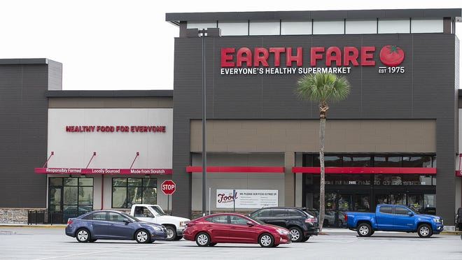 A truck makes its way past the Earth Fare supermarket in the Shady Oaks Shopping Center in Ocala on Tuesday. A reboot of the supermarket chain announced it plans to reopen the Ocala location in September.