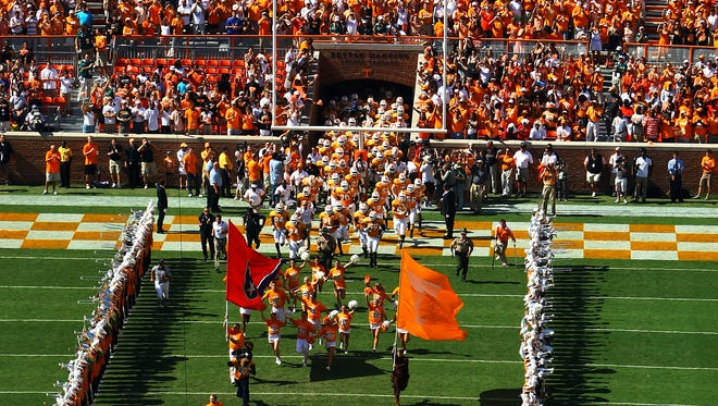 """The football team runs through the """"T"""" before the University of Tennessee plays Florida at Neyland Stadium in Knoxville Sept. 18, 2010"""