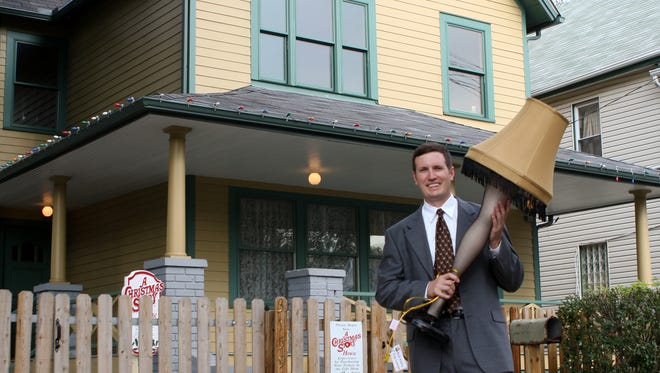 Brian Jones, owner of the Cleveland house featured in 'A Christmas Story,' hefts a leg lamp. They're for sale in the gift shop.