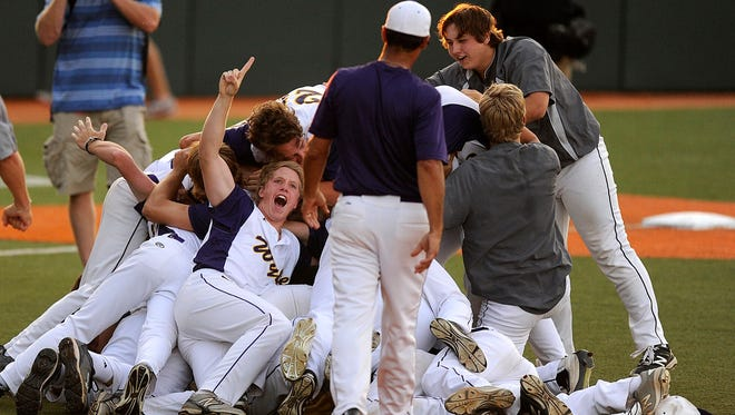 Wylie players celebrate after the final out of the Bulldogs' 3-2 win over Salado in the Class 4A baseball state championship game on Thursday, June 9, 2016, at Disch-Falk Field in Austin.