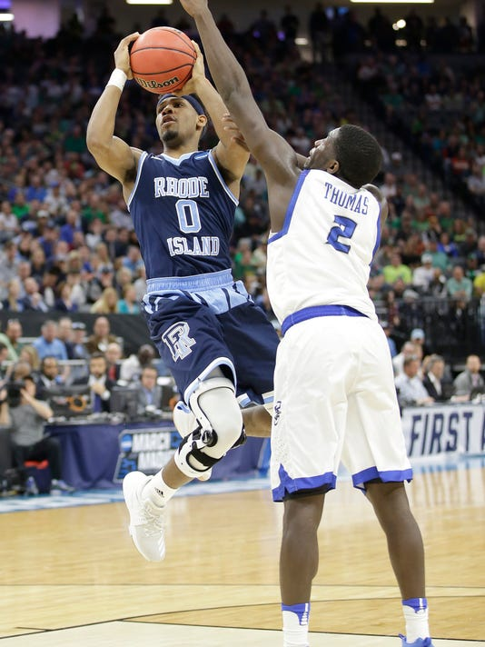 Rhode Island guard E.C. Matthews, left, goes to the basket against Creighton guard Khyri Thomas during the first half of a first-round game of the men's NCAA college basketball tournament Sacramento, Calif., Friday, March 17, 2017. (AP Photo/Rich Pedroncelli)