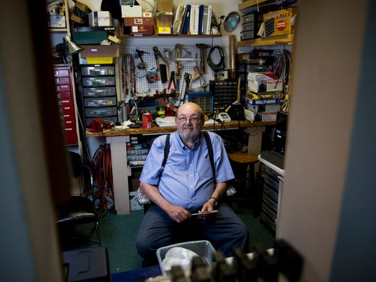 Jim Overman, of Golden Gate, Fla., is a model train enthusiast and member of Scale Rails of Southwest Florida. Overman, a man who made his career on Wall Street, has helped to build and decorate the club's model train sets located in north Fort Myers.
