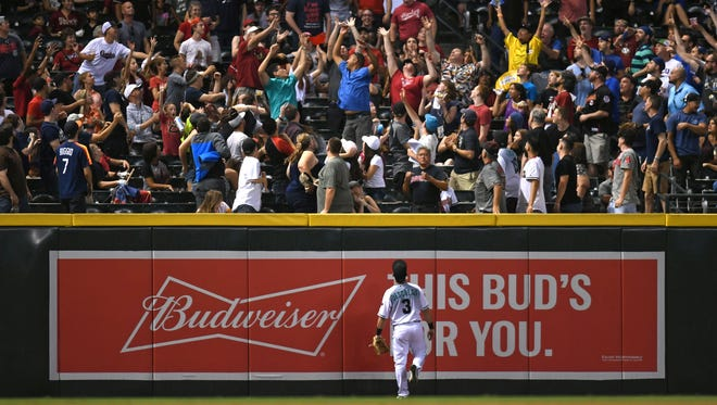 Jun 9, 2017; Phoenix, AZ, USA; Arizona Diamondbacks second baseman Daniel Descalso (3) watches as fans attempt to catch a home run ball hit by Milwaukee Brewers left fielder Hernan Perez (not pictured) during the fifth inning at Chase Field. Mandatory Credit: Joe Camporeale-USA TODAY Sports