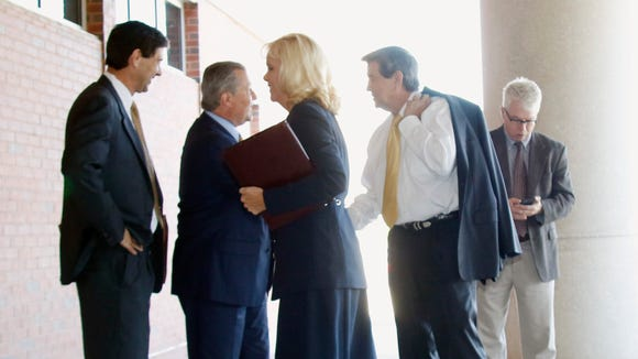 Alabama House Speaker Mike Hubbard, second from left, and former Gov. Bob Riley shake hands outside the Lee County Justice Center after Susan Hubbard, foreground, and Rob Riley, left, greet one another, on Friday, June 3, 2016,  in Opelika, Ala. Testimony resumes Friday in the ethics trial of Hubbard. (Todd J. Van Emst/Opelika-Auburn News via AP, Pool)