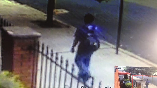 Garfield police are searching for a man suspected in two car burglaries.