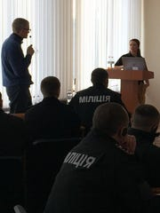 Reno Police Officer Amanda Hartshorn leads a training class in Kiev.