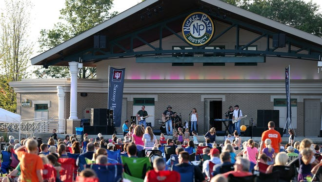 The Blue River Band performs at the Nickel Plate Amphitheater, Tuesday, July 8, 2014, in Fishers. Thousands of people turn out weekly for the concert series.
