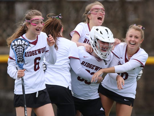 Ridgewood celebrates it's 7-4 win over Summit getting a pay back win over the team that beat them in the Tournament of Champions last season by one goal.