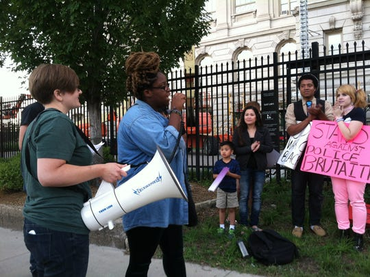 Kaija Carter, 17, of Des Moines speaks out during a protest in response to the police killing of unarmed people.