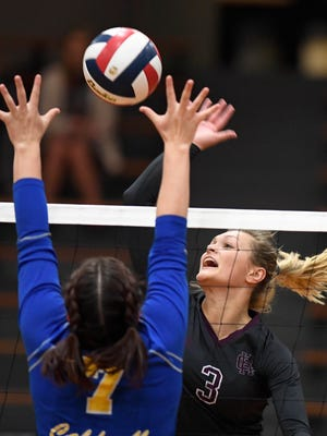 Henderson's Hannah Watkins (3) battles at the net against Caldwell's Carlie Peek (7) as Henderson County plays long-time rival Caldwell County in the Second Region Volleyball Tournament championship at Trigg County High School Thursday, October 26, 2017.