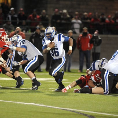 The Zanesville offensive line opens up a hole for Leo