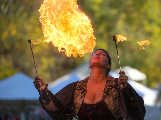 Katy Solko of Fandazzi Fire Circus from Minnesota astounds the crowds with fire breathing.