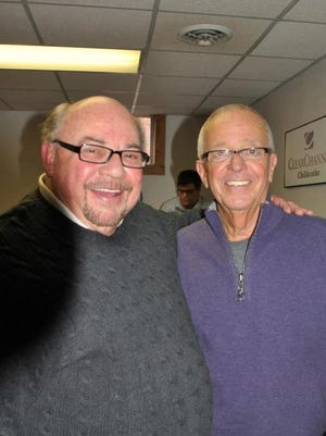 John Wend, left, stands with Cincinnati Reds radio announcer Marty Brennaman during a 2013 Reds Winter Caravan visit at WKKJ.