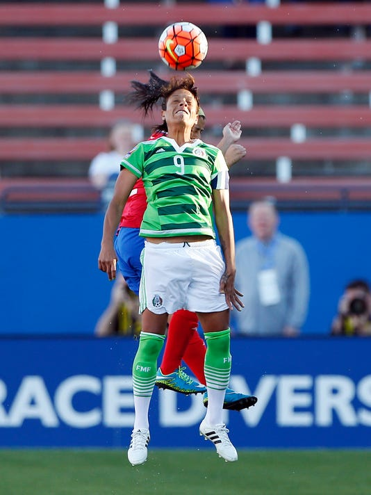 Mexico forward Maribel Dominguez Castelan (9) heads the ball as Costa Rica defender Lixy Maria Rodriguez Zamora, background, defends during the first half of a women's Olympic qualifying soccer match, Monday, Feb. 15, 2016 in Frisco, Texas. Costa Rica won 2-1. (AP Photo/Brandon Wade)