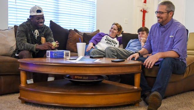 JaJuan Cherry (left) jokes with his family, Dana Tedders, Deven Tedders, and Dylan Tedders Friday, Dec. 1, 2017, at the Tedders home in Okeechobee.